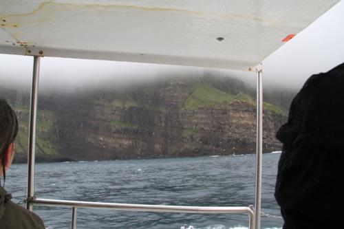 boat cliffs mykines